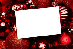 White page on red christmas baubles Royalty Free Stock Image