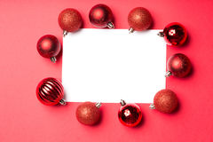 White page surrounded by christmas baubles Stock Photo