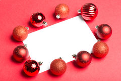 White page surrounded by christmas baubles Stock Photos