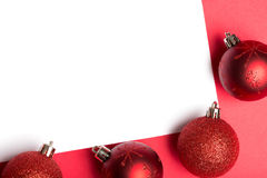 White page surrounded by christmas baubles Royalty Free Stock Images