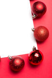 White page surrounded by christmas baubles Stock Photography