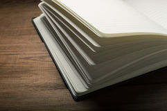 White pages of notepad on the wooden table.  Royalty Free Stock Image