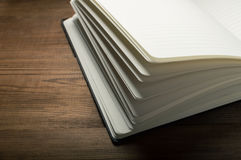 White pages of notepad on the wooden table.  Royalty Free Stock Photos