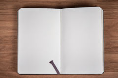 White pages of open notebook on a brown wooden table Stock Photo