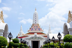 White Pagoda. White Pagoda in the bright sky and clouds Stock Photo