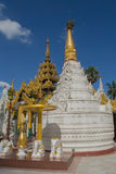 White pagoda on the background of blue sky. Yangon Myanmar Stock Photography