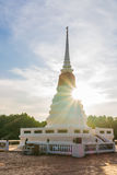 White pagoda on background shining sun. stock image