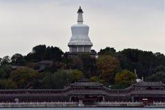 A white pagoda in Beihai. Beihai Baita, located in Beijing Beihai Park Qionghua Island, built in the early Qing Shunzhi eight years 1651, is a Tibetan Lama tower Stock Photo