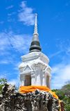 White pagoda & Buddha statue on blue sky Royalty Free Stock Photography