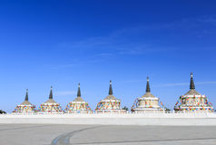 The White Pagoda forest. The white Pagoda is a landmark of Tibetan Buddhism,it bring people a peaceful and tranquil feeling Royalty Free Stock Photography