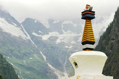 White Pagoda in front of snow mountains Royalty Free Stock Image