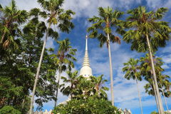 White pagoda in garden at thai temple Stock Images