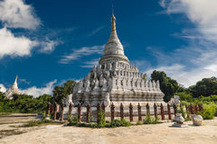 White Pagoda at Inwa city with lions guardian statues. Myanmar Royalty Free Stock Images