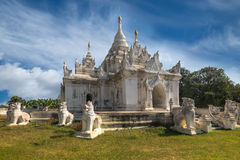 White Pagoda at Inwa city with lions guardian statues. Myanmar Stock Photography