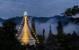 White pagoda in a mist. Wat Phra That Doi Kong Mu illuminated at dawn, Mae Hong Son, Thailand stock image
