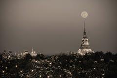 White pagoda in Phra Nakhon Khiri Historical Park with full moon Stock Photo