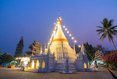 White pagoda in Wat Phra That Doi Gongmu landmark of Maehongson Royalty Free Stock Photo