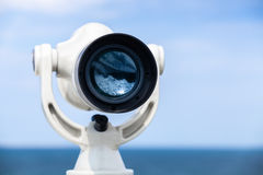 White paid telescope stands on sea coast Royalty Free Stock Photography