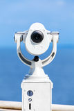 White paid telescope stands on sea coast Royalty Free Stock Photos