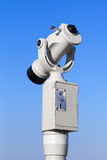 White paid tourist telescope on sky background Royalty Free Stock Photography