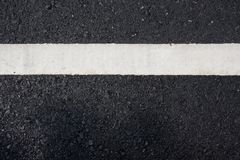 White paint line on asphalt road Royalty Free Stock Photography