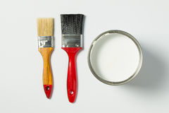 White paint and paint brushes Royalty Free Stock Photos