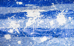 White paint on plastic blue sheet Stock Images