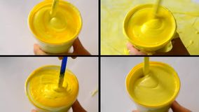 White paint poured yellow paint pigment mixed stirred agitated stock video footage