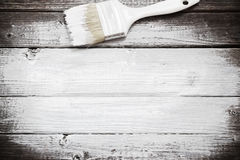 White paint space with paintbrush. On wood background royalty free stock photos