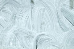 White strokes on a window. White paint steokes in a window, abstract background or texture royalty free stock photography