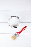 White paint tin and paint brush on it Royalty Free Stock Image