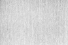 White paintable wallpaper on the wall. Clean background te Royalty Free Stock Photos