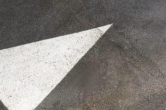 White painted arrow. On asphalt road royalty free stock image