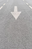 White painted arrow on grey asphalt road Royalty Free Stock Photos