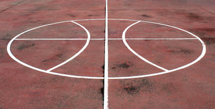 White painted basketball on a court royalty free stock image