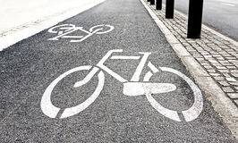 White painted bike path signs on asphalt Royalty Free Stock Photography