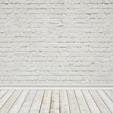 White painted brick wall and vintage wooden floor, interior background. For montages Royalty Free Stock Photo