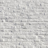 White painted bricks at an old house wall Stock Photos