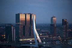 White Painted Bridge Near High Rise Building Under Blue Sky during Sunset Stock Images
