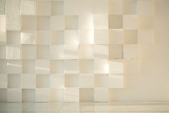 White painted concrete wall made of cubes with tiled floor Stock Images