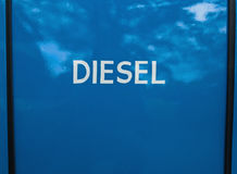 White painted diesel sign on blue background Royalty Free Stock Images