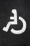 White painted disabled sign. Stock Images