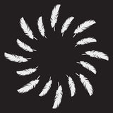 White painted feathers folded into a circle Royalty Free Stock Photography