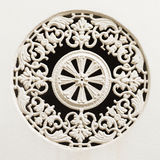 White painted historic cast iron window ornament Stock Photo