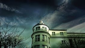 White Painted House Under Cloudy Sky Royalty Free Stock Images