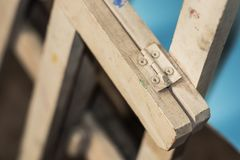 Iron hinge. White painted iron hinge. Concept tool and work Stock Photos