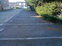 White painted lines on concrete indicating designated parking Royalty Free Stock Photos