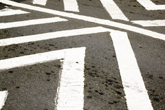 White Painted Pedestrian Crossing On Tarmac Roadway Royalty Free Stock Image
