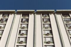 White Painted Residential Building Under Clear Skies Stock Image