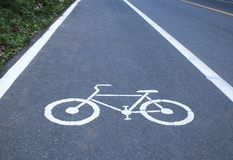 Bike pathway. White painted sign for bike path Royalty Free Stock Image